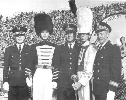J. Robert Schlatter (center), with two former students and the IU and Purdue Band Directors